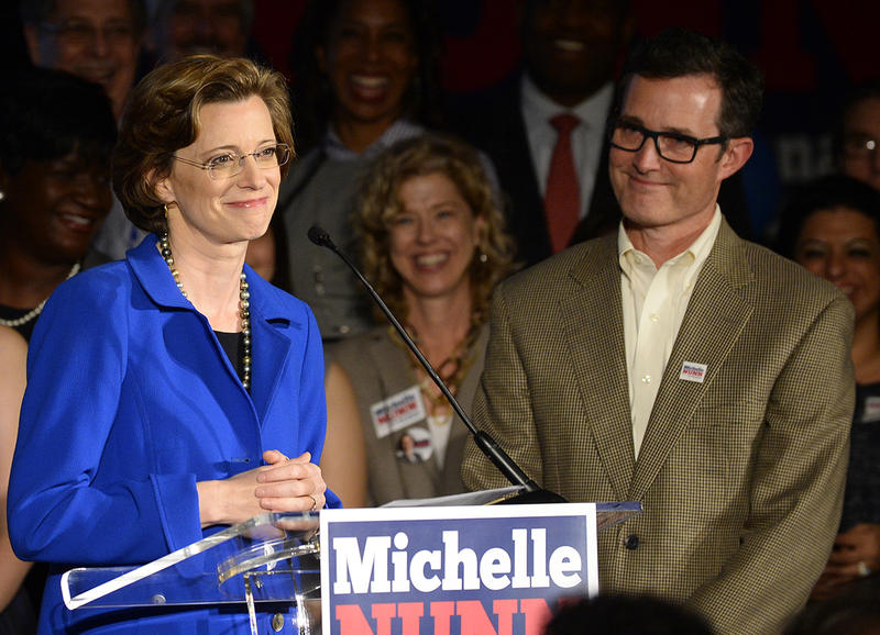 Michelle Nunn, accompanied by her husband Ron Martin, concedes the election to Republican David Perdue