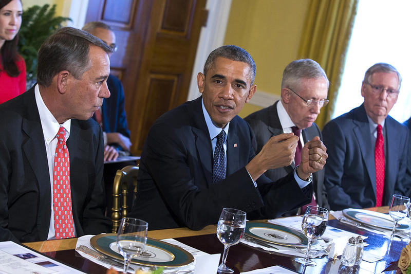 President Barack Obama meets with House Speaker John Boehner, Senate Majority Leader Harry Reid, and Senate Minority Leader Mitch McConnell in the Old Family Dining Room of the White House in Washington.