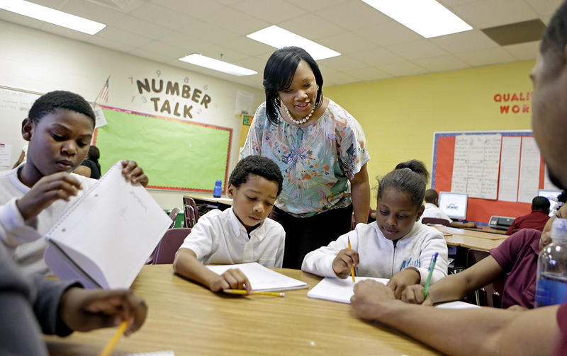 Burgess-Peterson Elementary School principal Robin Robbins meets with students during an after-school study program in Atlanta, in preparation for last year's state standardized testing.