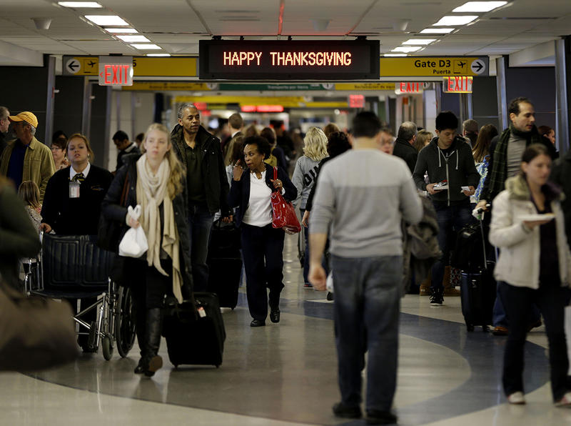 Passengers wait for their planes during the big Thanksgiving travel season at LaGuardia Airport in New York last year.
