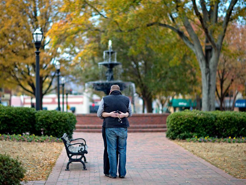 A couple embrace in Marietta Square in Cobb County.