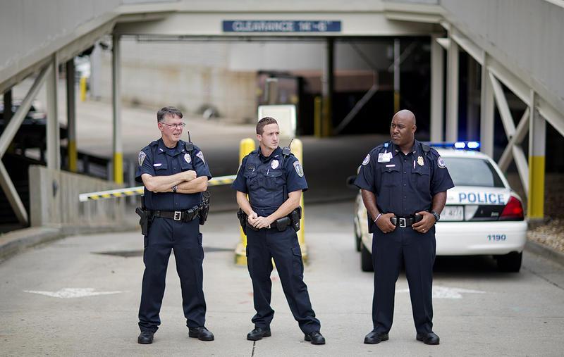 Police guard an entrance to Emory University Hospital.