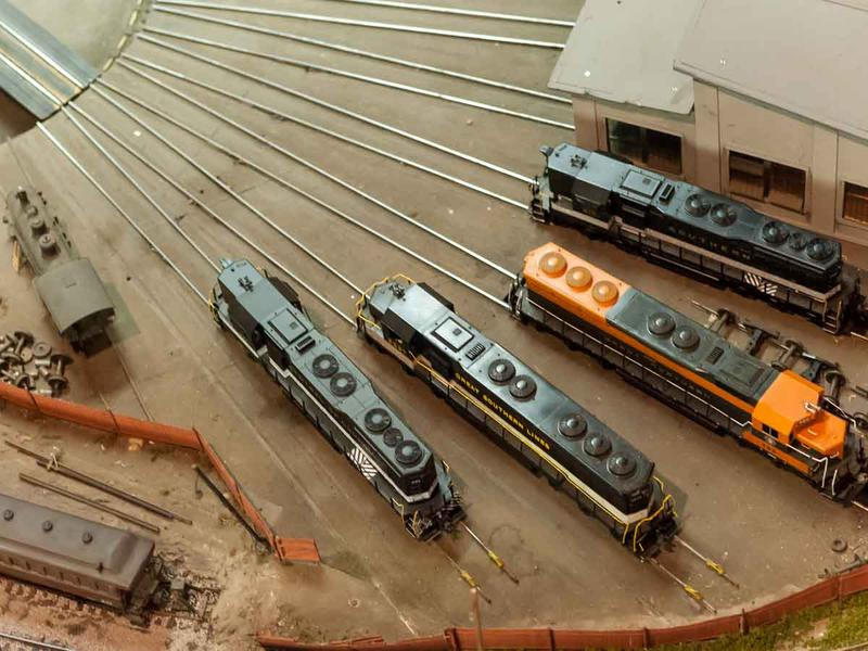 Trains parked in the roundhouse at the Railroad Model Club
