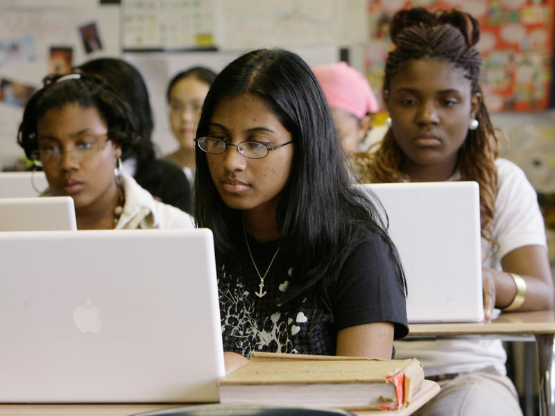 Ninth-grade honors English students Jennifer Smith, left, Ruth Thomas, and Jaleesa Thomas, no relation, work on laptop computers during class at Philadelphia High School for Girls in Philadelphia, Thursday, May 10, 2007.
