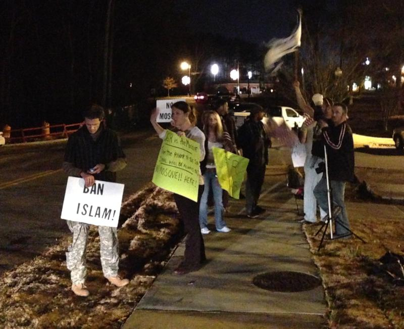 Demonstrators outside the Kennesaw City Council meeting on December 1, 2014, demanding the Council reject a zoning request from a local Muslim congregation.  The Council rejected the request, but has scheduled a second vote for December 15, 2014.