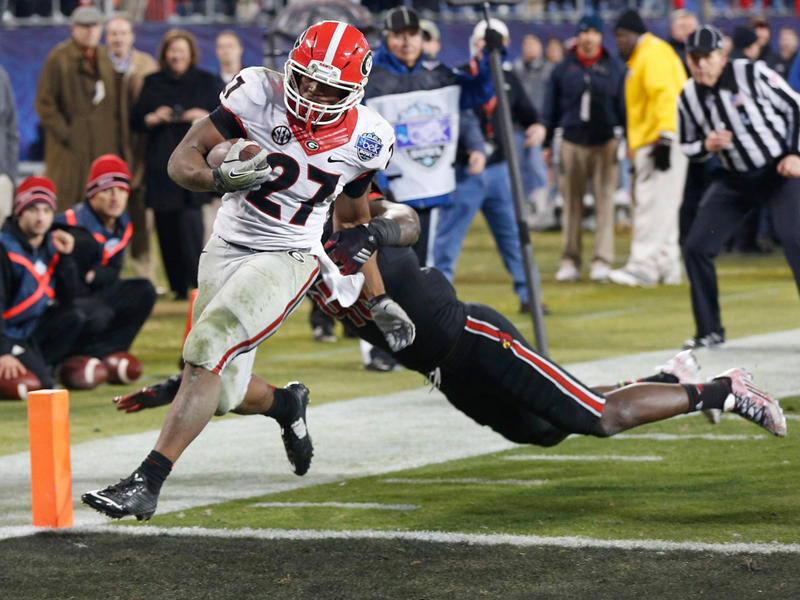 Georgia's Nick Chubb (27) runs into the end for a touchdown against Louisville late in the second half of the Belk Bowl NCAA college football game in Charlotte, N.C., Tuesday, Dec. 30, 2014. Georgia won 37-14. Chubb was the game's MVP.