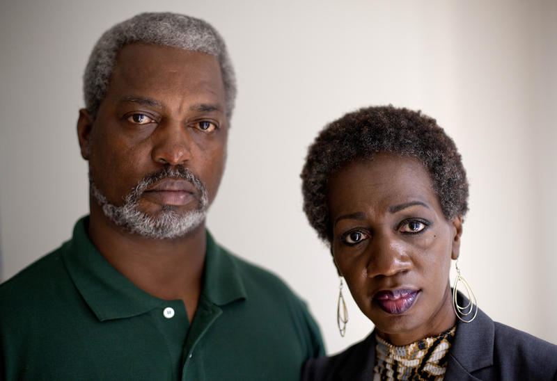 Pam Champion, right, and Robert Champion, Sr., left, the parents of Florida A&M University drum major Robert Champion, who died in a hazing incident, are photographed in their attorney's office following a press conference May 23, 2012, in Atlanta.
