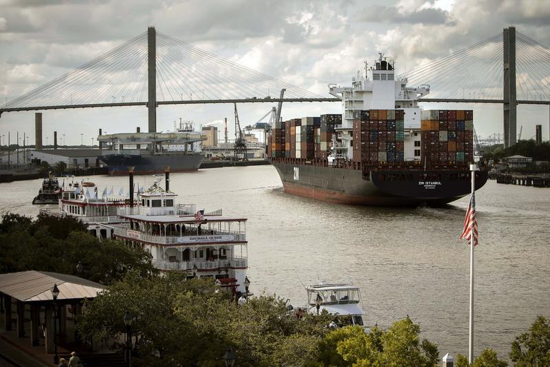 The container ship Zim Istanbul makes it's way up the Savannah River past historic River Street in Savannah, Ga., on Tuesday, Oct. 7, 2014, to the Port of Savannah.