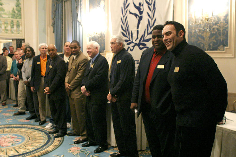 Tony Casillas, right, a 1982-85 Oklahoma middle guard, and Tracy Rocker, a 1985-88 Auburn defensive tackle, second from right, join the 2004 College Football Hall of Fame Class at a National Football Foundation announcement in New York on Dec. 7, 2004.