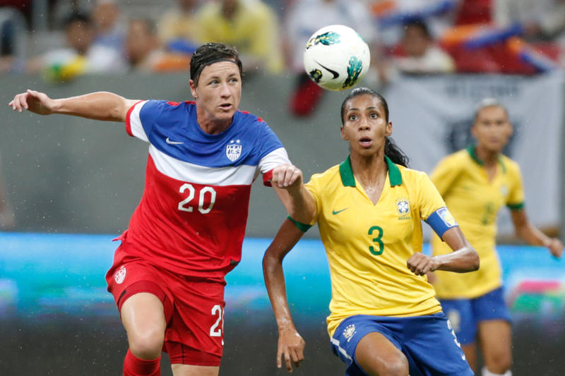 United States' Abby Wambach, left, fights for the ball with Brazil's Bruna Benites, right, during a final match of the International Women's Football Tournament at the National Stadium in Brasilia, Brazil, Sunday, Dec. 21, 2014.