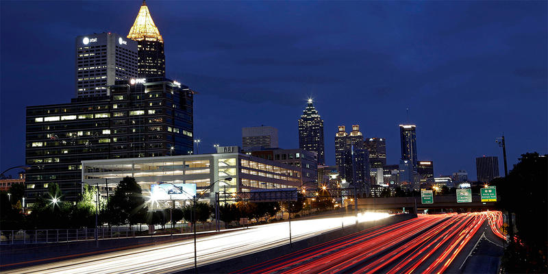 In this July 9, 2012, photograph made using a long exposure, traffic moves along Interstate 75 against the downtown skyline in Atlanta.