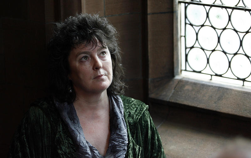 Writer and poet Carol Ann Duffy poses for photographs at John Rylands Library in Manchester, England, Friday, May 1, 2009, after being named as Britain's poet laureate.