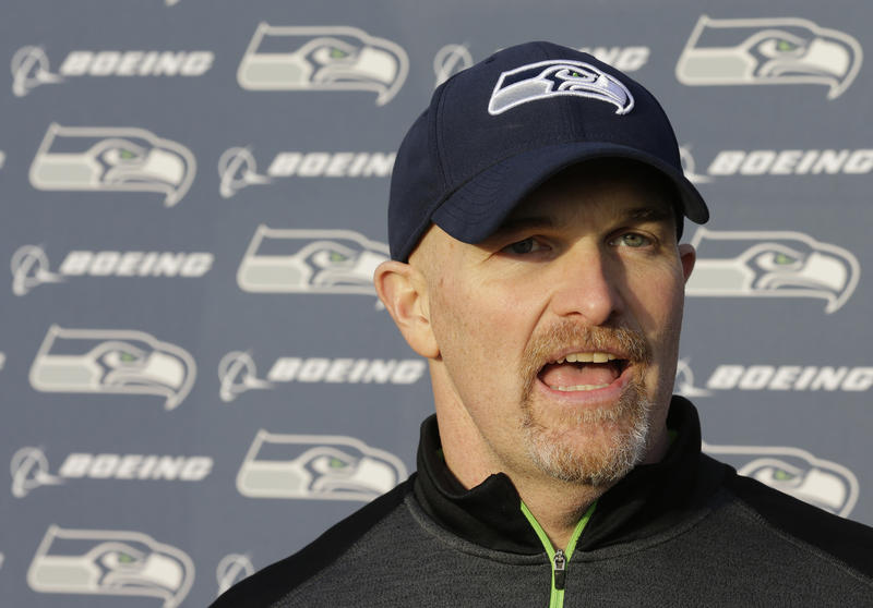 Seattle Seahawks defensive coordinator Dan Quinn talks to reporters after practice Wednesday, Jan. 7, 2015 in Renton, Wash. The Seahawks will play the Carolina Panthers on Saturday in an NFL football divisional playoff game.