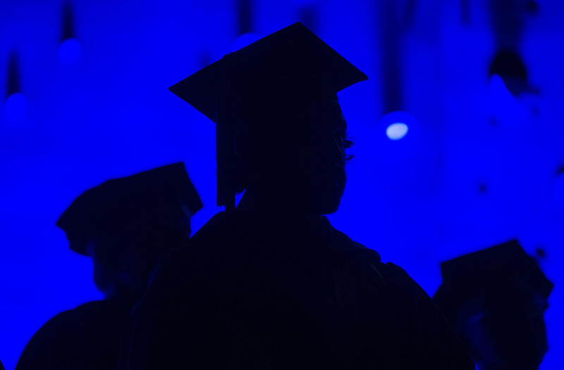 In this Saturday, May 31, 2014 photo, members of the graduating class and faculty attend the SCAD Commencement in Atlanta. On Thursday, Nov. 13, 2014, the College Board said the average cost of attending college crept up again in 2014.