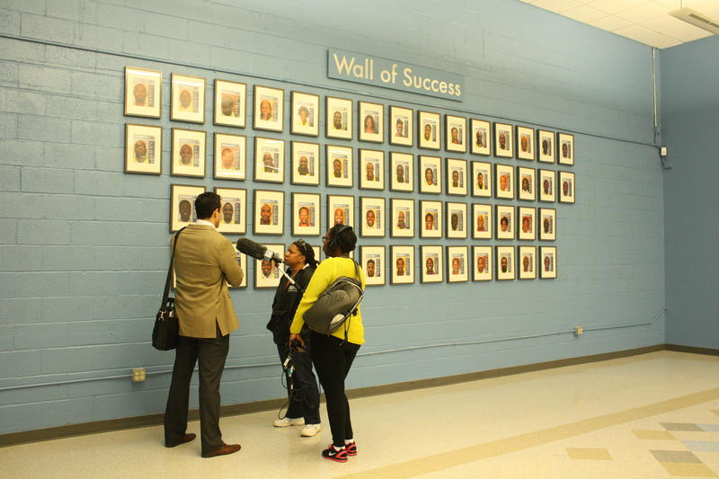 The ''Wall of Success'' bears portraits of Westside Works program graduates.