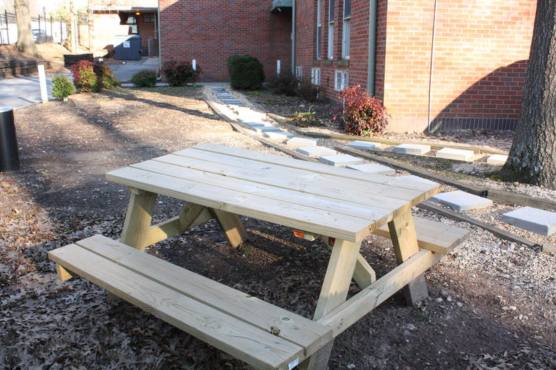 Job training participants built this picnic table and laid personalized paving stones behind it.