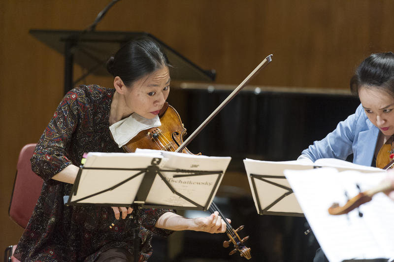Violinist Midori (left) and violinist GaHyun Cho performing at UN headquarters in June, 2014. Midori performs with the Atlanta Symphony Orchestra February 20-21.