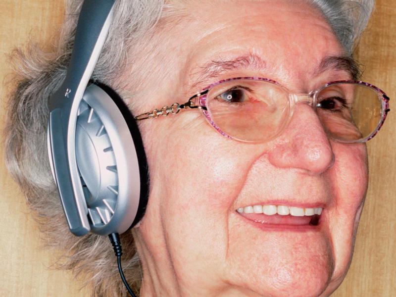 Old woman in headphones