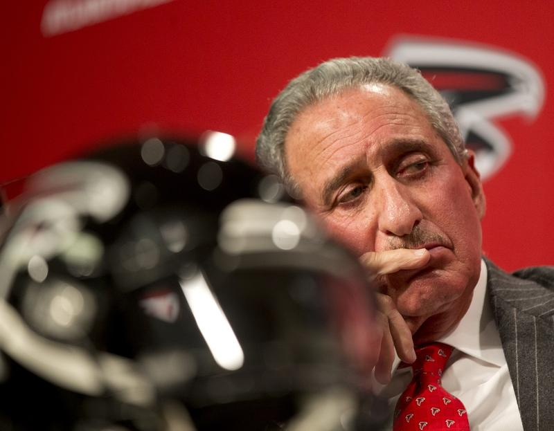 Atlanta Falcons owner Arthur Blank looks on during a news conference introducing former Seattle Seahawks defensive coordinator Dan Quinn as the NFL football team's new head coach, Tuesday, Feb. 3, 2015, in Flowery Branch, Ga.