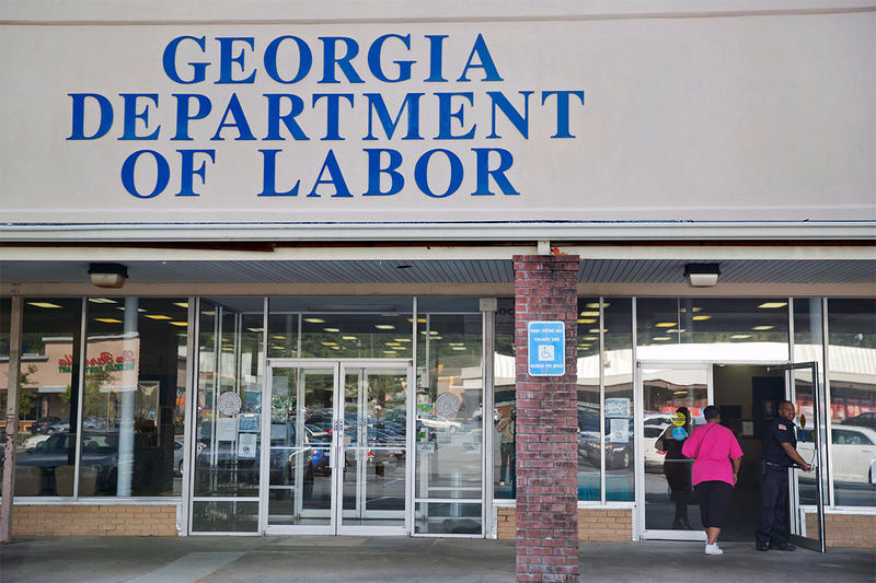 A woman walks into a Georgia Department of Labor career center, Friday, Sept. 19, 2014, in Atlanta.