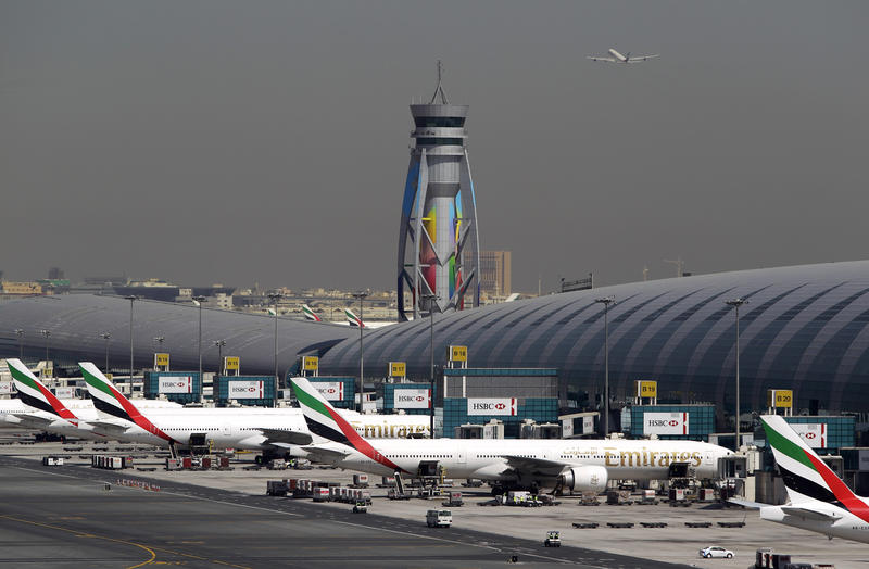 In this May 8, 2014 file photo, Emirates passenger planes are parked at their gates of Dubai airport in United Arab Emirates.