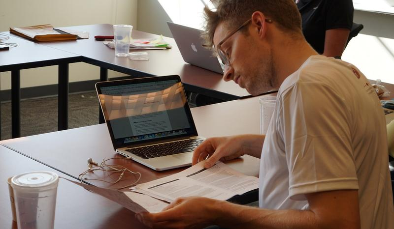 Benjamin Ebeling of the University of Copenhagen prepares his team's case as part of Emory's Global Health Case Competition. Teams came to Atlanta from across the U.S. and as far away as Australia.