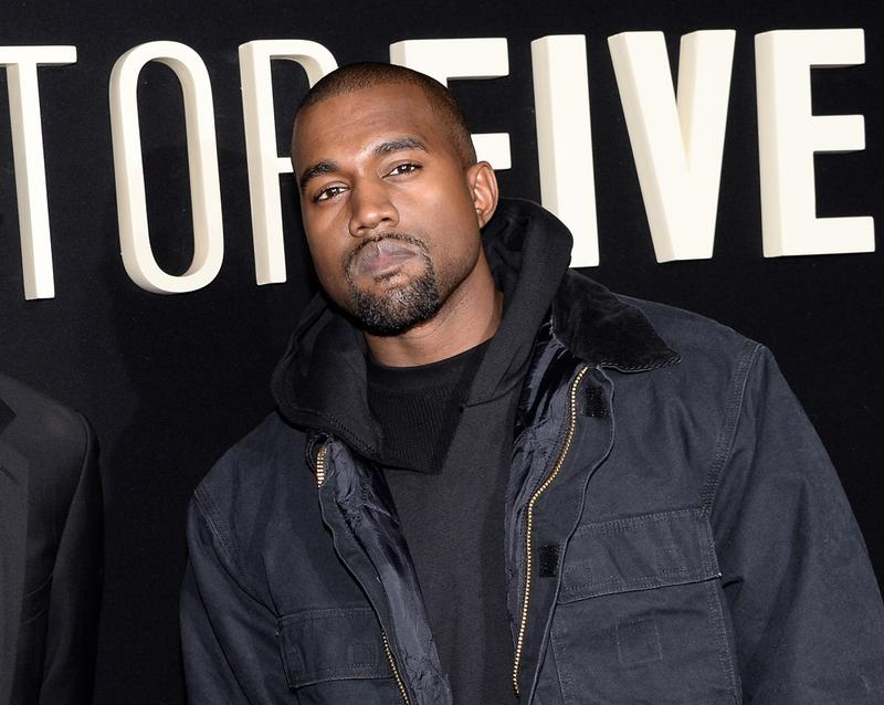 "In this Dec. 3, 2014 file photo, Kanye Wests attend the premiere of ""Top Five"" at the Ziegfeld Theatre in New York."