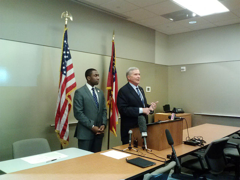 Dekalb County Interim CEO Lee May and Mike Bowers at the podium