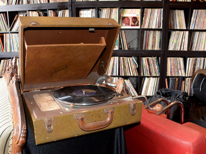 Ricci de Forest's collection includes old records and record players like this one.