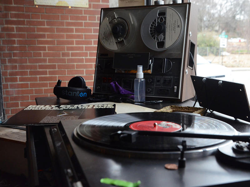 Passersby can watch de Forest honor WERD by playing records from the station's era.