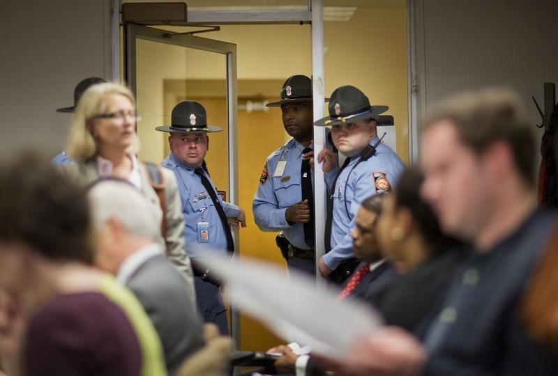 "Officers stand at the door to a packed House subcommittee panel on a ""religious freedom"" bill, Wednesday, March 25, 2015, in Atlanta.  The panel heard hours of testimony on Tuesday, the first action on the issue in the House this session."