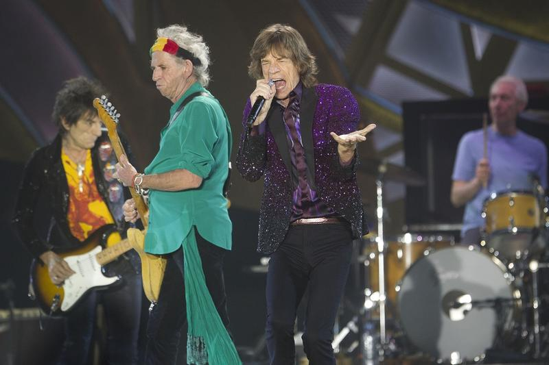 Rolling Stones singer Mick Jagger, performs with Keith Richards, Ronnie Wood, left, and drummer Charlie Watts during a concert in Hayrkon Park in Tel Aviv, Israel, Wednesday, June 4, 2014.