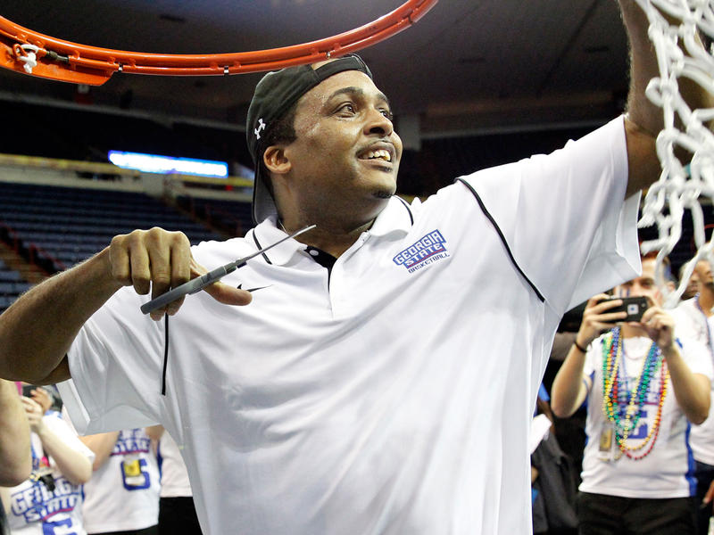 Georgia State head coach Ron Hunter cuts the net after defeating Georgia Southern 38-36 in the NCAA college basketball championship of the Sunbelt Conference tournament in New Orleans, Sunday, March 15, 2015.