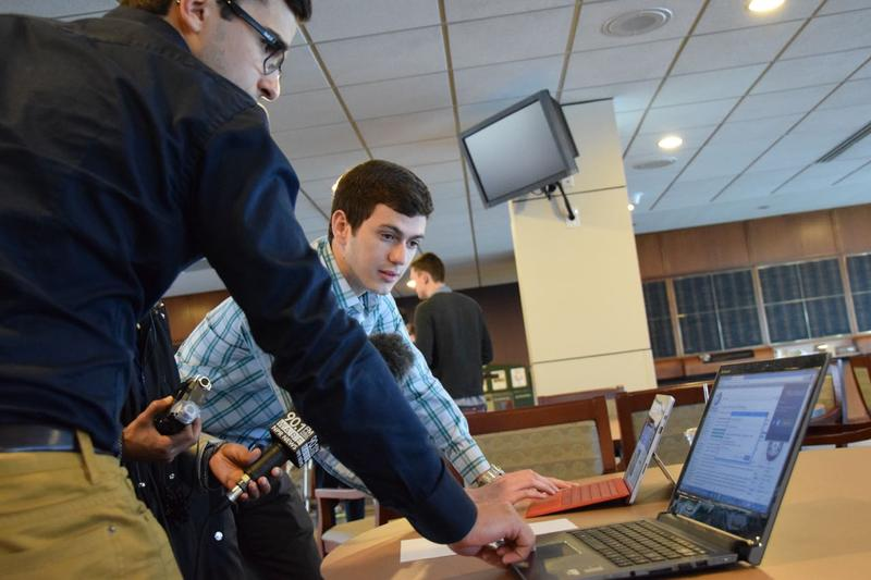 Miguel Oller (pictured) and Ricardo DeAndrade demonstrate Shortweb which highlights the relevant information on a webpage.The Shortweb developers and five other finalists will compete for the 2015 InVenture Prize at Georgia Tech April 1, 2015.