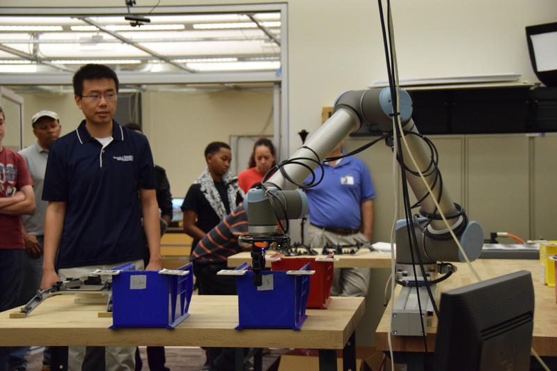 Henry Hu demonstrates the 'Excel' robot. Students from around the metropolitan Atlanta area participated in the event as part of National Robotics Week. April 8, 2015.