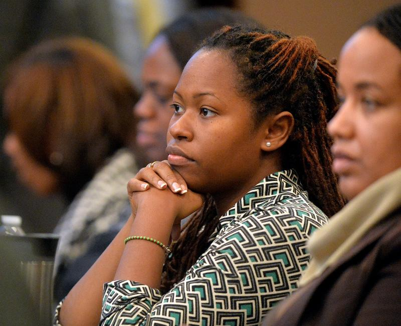 Former APS Dunbar Elementary teacher Shani Robinson listens as Kathleen Mathers, the former executive director of the Governor's Office of Student Achievement, continues her testimony under cross examination Wednesday afternoon Nov. 5, 2014, in Atlanta du