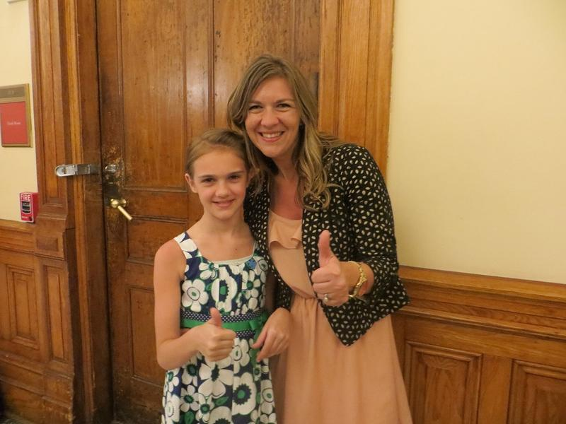 After the autism treatment coverage bill passed the Georgia House Anna Bullard, right, and Ava, left, give a thumbs up.