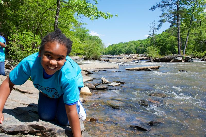 M. Agnes Jones third grader Leticia Cotton plays on the bank of Sweetwater Creek.