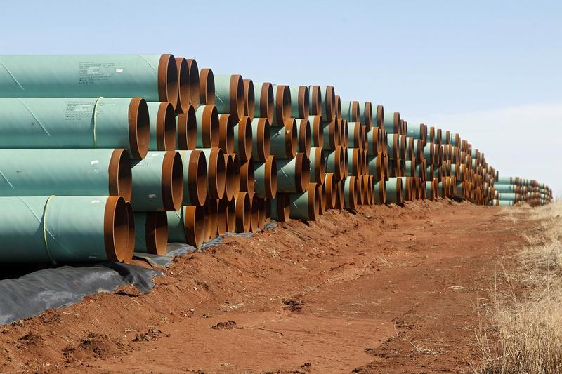 In this Feb. 1, 2012 file photo, miles of pipe for the stalled Canada-to-Texas Keystone XL pipeline are stacked in a field near Ripley, Okla.