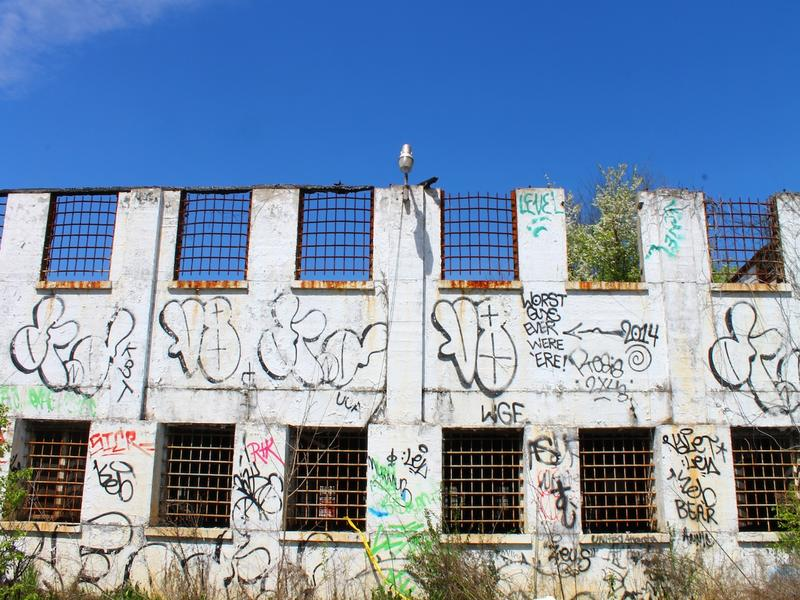 The old Atlanta Prison Farm dormitories are now covered in graffiti.