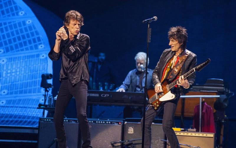 Mick Jagger, Chuck Leavell and Ronnie Wood of the Rolling Stones perform at the United Center on Friday, May 31, 2013 in Chicago.