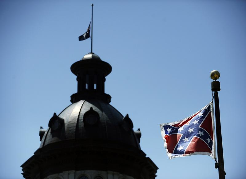 In this June 19, 2015, photo, a Confederate flag flies near the South Carolina Statehouse in Columbia, South Carolina.