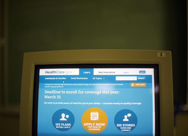 A computer screen welcomes applicants to apply for health insurance online at the Atlanta Medical Center South Campus, Monday, March 31, 2014, in Atlanta.