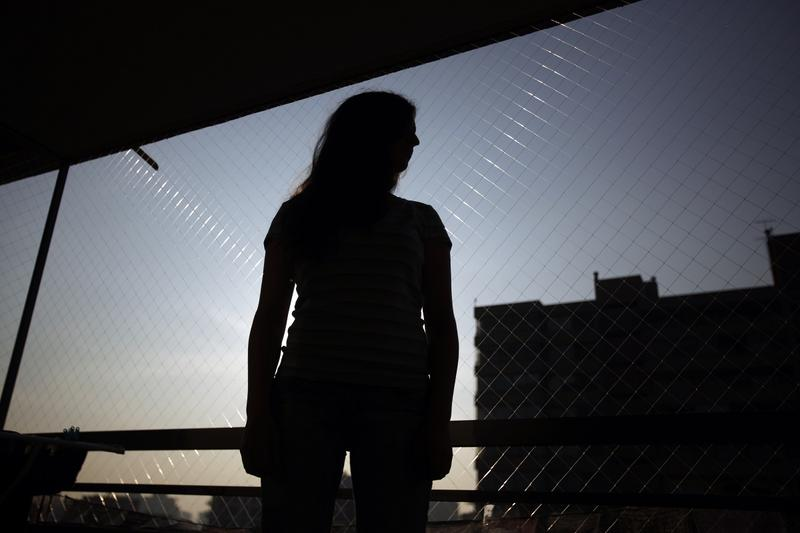 In this May 13, 2015 photo, a 25-year-old woman who did not want to be identified, who used misoprostol to terminate an unplanned pregnancy in January, poses for a photo in Santiago, Chile.