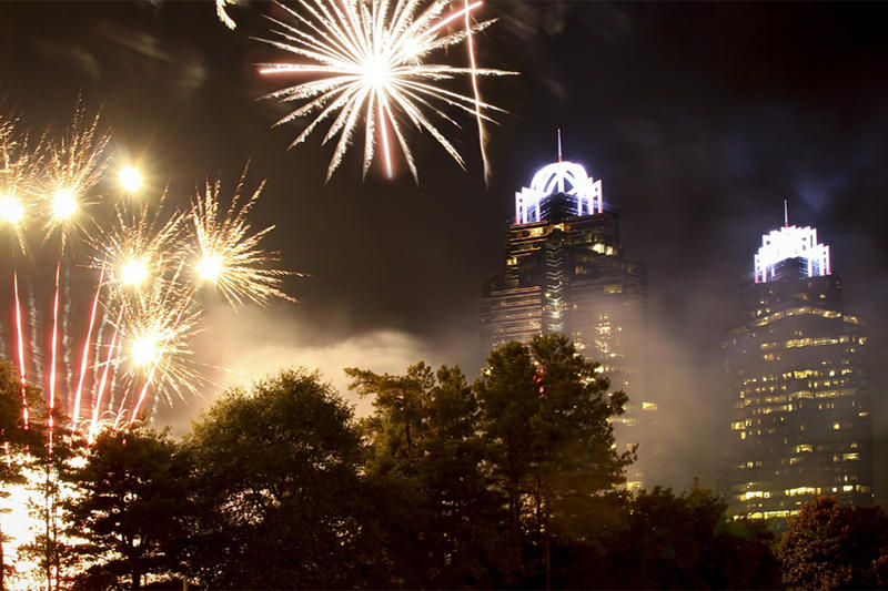 Fireworks light up the sky over the King and Queen Buildings in Sandy Springs, Georgia.