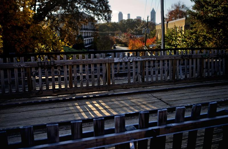 In this Nov. 20, 2012 photo, a section of old rail tracks is preserved next to the Atlanta BeltLine as the midtown skyline stands in the background in Atlanta.