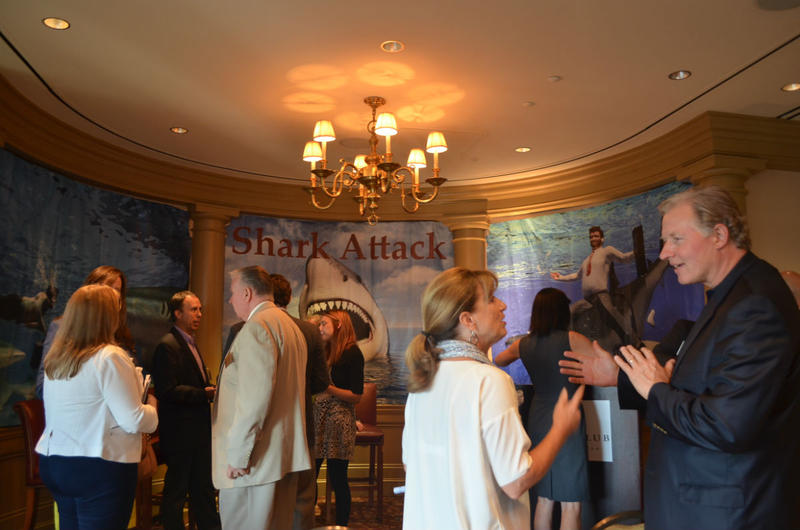 Large local corporations, like AT&T and Coca-Cola, are looking to invest in start-ups and absorb the companies into their  accelerator programs. Entrepreneurs and investors mingle after a Corporate Shark Attack event at the Atlanta Financial Center in Buc
