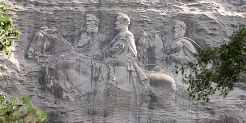 The carving depicts Confederate Civil War figures Stonewall Jackson, Robert E. Lee and Jefferson Davis in Stone Mountain.The first sketches for the carving were drawn up in 1915 at the request of the United Daughters of the Confederacy.