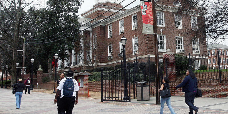 People walk across the Clark Atlanta university campus in Atlanta.