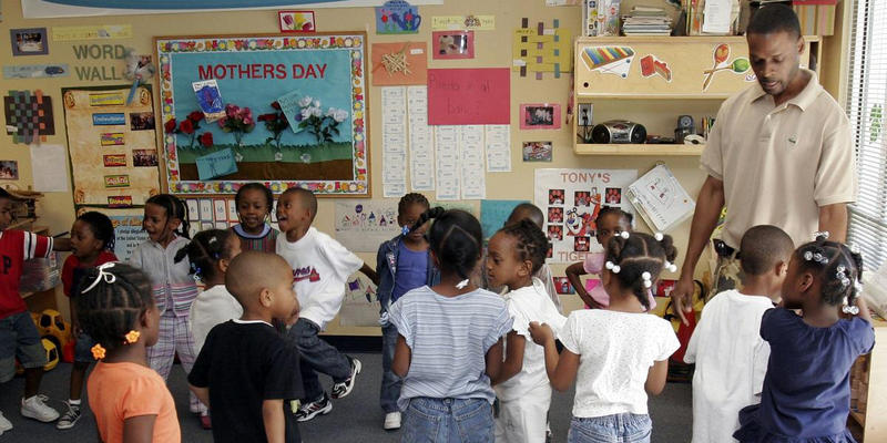 Tony Bennett, right, lead teacher at the Sheltering Arms, an early education and family center in Atlanta, Ga. works with a group of Pre-K students Thursday, May 10, 2007. A study released by the Southern Education Foundation reported that the South is le